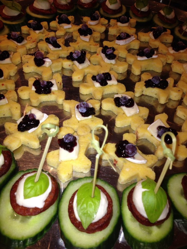 """Polenta """"Ginger Bread Men"""" topped with Brie & Blueberry"""