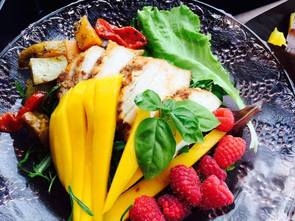 Roasted chicken breast and fresh fruit and vegtables